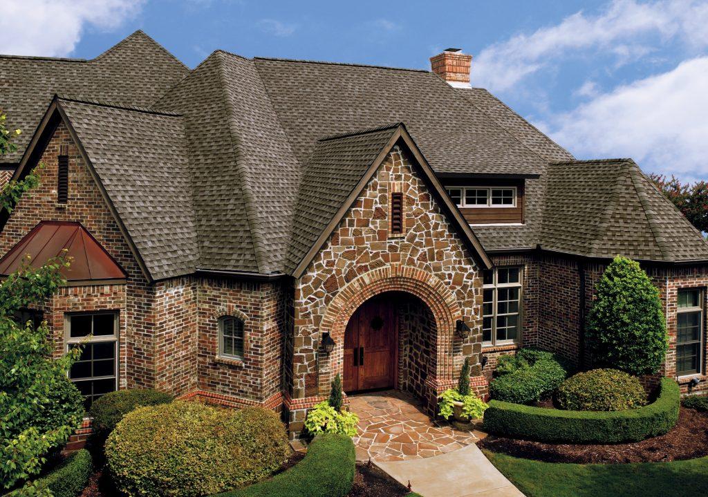beatiful house with shingle roof style