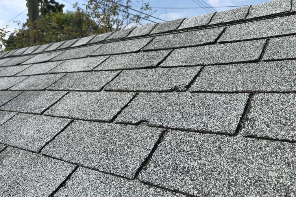 cracked shingle broken shingle replacement roofer elmer's roofing